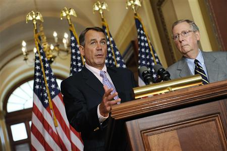U.S. House Speaker John Boehner (R-OH) (L) and Senate Minority Leader Mitch McConnell (R-KY) (R) speak at a news conference about the U.S. debt ceiling crisis at the U.S. Capitol in Washington July 30, 2011. REUTERS/Jonathan Ernst