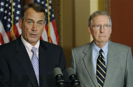 House Speaker John Boehner (R-OH) (L) and Senate Minority Leader Mitch McConnell (R-KY) (R) hold a news conference about the U.S. debt ceiling crisis at the U.S. Capitol in Washington July 30, 2011. REUTERS/Jonathan Ernst