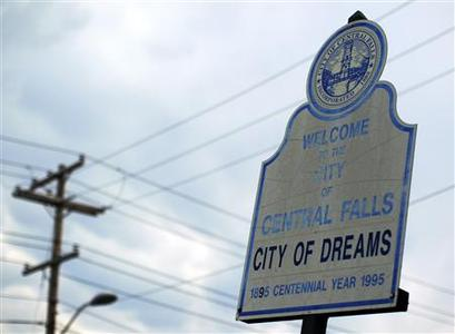 A sign calling Central Falls, Rhode Island a ''City of Dreams'' marks the town's boundary on Higginson Avenue August 1, 2011. REUTERS/Brian Snyder