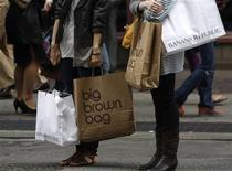 <p>Shoppers carry their purchases along Broadway in New York City, May 11, 2008. REUTERS/Joshua Lott</p>