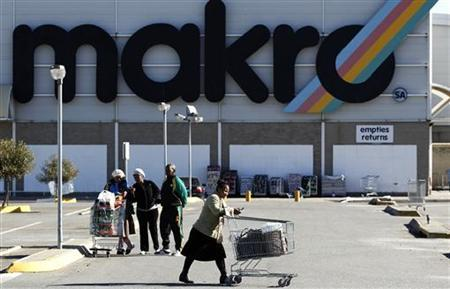 Shoppers leave the Makro branch of South African retailer Massmart in Johannesburg May 31, 2011. REUTERS/Siphiwe Sibeko