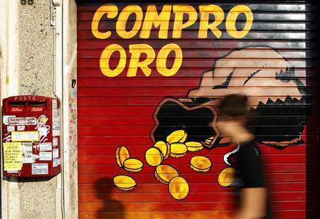 A man walks past a closed shop with a sign reading 'Buy gold' in downtown Rome, August 1, 2011. REUTERS/Tony Gentile