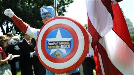 A man dressed as Captain America poses as dozens of Tea Party supporters rally near the Capitol against raising the debt limit in Washington, July 27, 2011. REUTERS/Jonathan Ernst