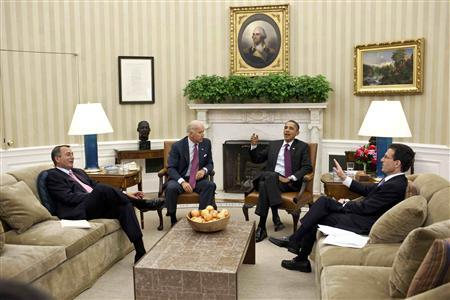 President Barack Obama (2nd R) and Vice President Joe Biden (2nd L) meet with House Speaker John Boehner (L) and House Majority Leader Eric Cantor in the Oval Office at the White House in Washington in this July 20, 2011 photograph. REUTERS/Pete Souza/The White House/Handout