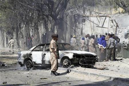 A view of the scene after a car bomb detonated along a street in Somalia's capital Mogadishu February 21, 2011. REUTERS/Omar Faruk