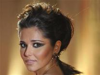 <p>Cheryl Cole poses at the BRIT music awards at the O2 Arena in London, February 15, 2011. REUTERS/Toby Melville</p>