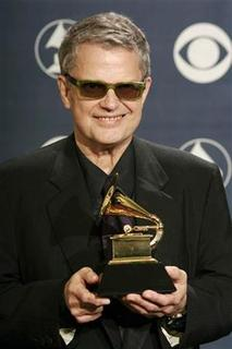 Charlie Haden poses backstage with his award at the 47th annual Grammy Awards at the Staples Center in Los Angeles February 13, 2005. He won for best latin jazz album with ''Land of the Sun.'' REUTERS/Mike Blake