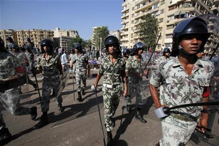 Military personnel clear protesters from Tahrir Square in Cairo August 1, 2011. REUTERS/Mohamed Abd El-Ghany