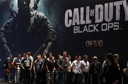 Visitors wait at an exhibition stand for ''Call of Duty - Black Ops'' at the Gamescom 2010 fair in Cologne August 18, 2010. REUTERS/Ina Fassbender