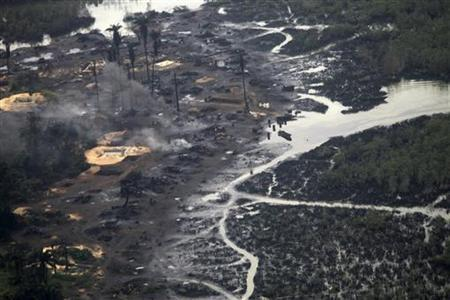 A view of an illegal oil refinery is seen in Ogoniland outside Port Harcourt in Nigeria's Delta region March 24, 2011. REUTERS/Akintunde Akinleye