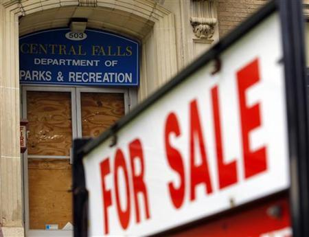 A ''For Sale'' sign is seen outside the boarded up entrance to the Central Falls Department of Parks and Recreation in Central Falls, Rhode Island August 1, 2011. REUTERS/Brian Snyder