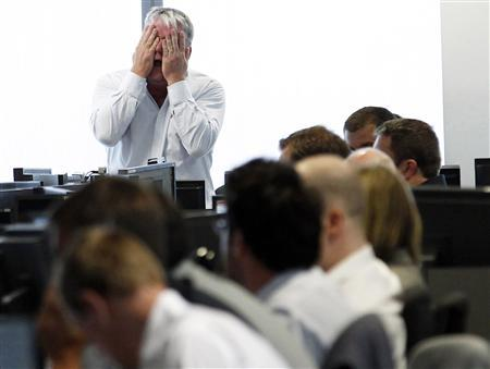 A broker reacts at BGC Partners at Canary Wharf financial district in London, August 5, 2011. REUTERS/Luke MacGregor