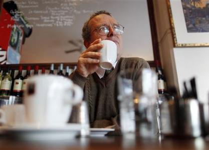 Bronte Capital Management Chief Investment Officer John Hempton drinks coffee in a cafe in Sydney July 1, 2011. REUTERS/Tim Wimborne