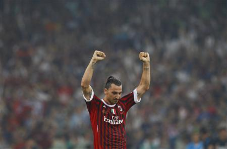 AC Milan's Zlatan Ibrahimovic celebrates after winning the Italian Super Cup soccer match against Inter Milan at the National Olympic Stadium, also known as the Bird's Nest, in Beijing, August 6, 2011. REUTERS/Petar Kujundzic