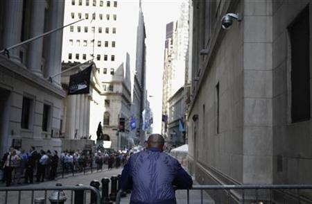 A trader stands outside the New York Stock Exchange following the end of the trading day, August 4, 2011. REUTERS/Brendan McDermid