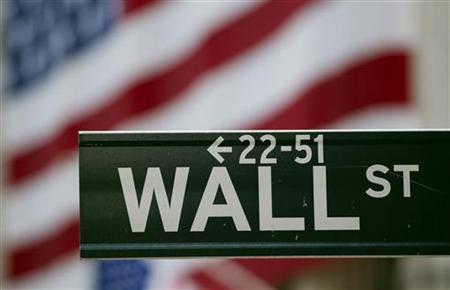 A Wall Street sign hangs on a signpost in front of the New York Stock Exchange August 5, 2011. REUTERS/Lucas Jackson