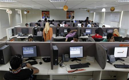 Employees work at a call centre, the first of its kind in the region run by Essar Group's business processing arm AEGIS, in Rangreth, on the outskirts of Srinagar, August 2, 2011. Picture taken August 2, 1011. REUTERS/Fayaz Kabli