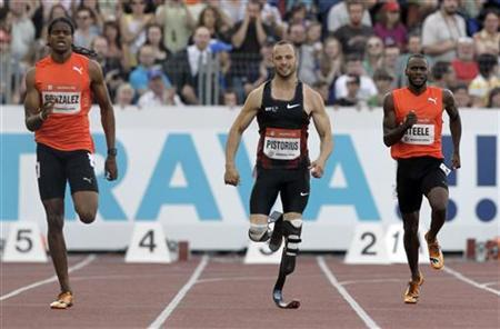 Jermaine Gonzales of Jamaica, Oscar Pistorius of South Africa and Edino Steele of Jamaica (L-R) compete in the 400 meters men's race at the IAAF World Challenge Ostrava Golden Spike meeting in Ostrava May 31, 2011. REUTERS/David W Cerny