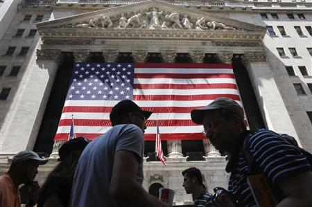 People walk outside the New York Stock Exchange August 8, 2011. REUTERS/Shannon Stapleton