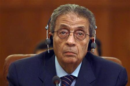 Amr Moussa listens to the speech of U.N. Secretary General Ban Ki-moon via video conference during a meeting at the Arab League headquarters in Cairo June 18, 2011. REUTERS/Amr Abdallah Dalsh