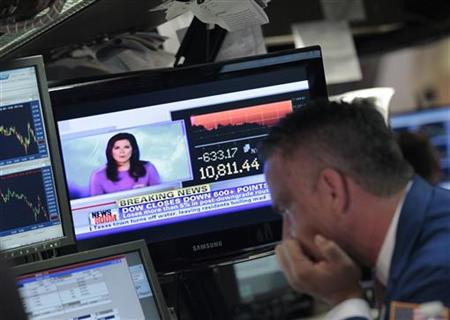 A trader watches his screen following the closing bell on the floor of the New York Stock Exchange August 8, 2011. REUTERS/Brendan McDermid