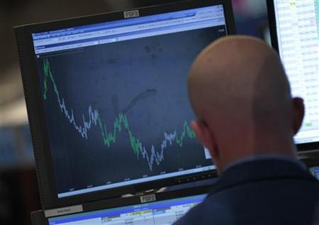 A Trader watches his screen on the floor of the New York Stock Exchange August 2, 2011. REUTERS/Brendan McDermid