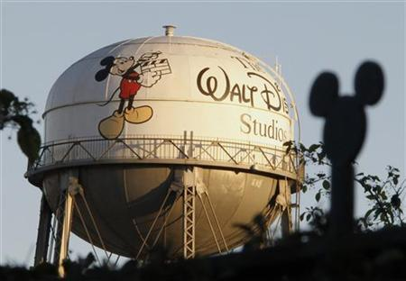The water tower at The Walt Disney Co., featuring the character Mickey Mouse, is seen behind a silhouette of mouse ears on the fencing surrounding the company's headquarters in Burbank, California, February 7, 2011. REUTERS/Fred Prouser