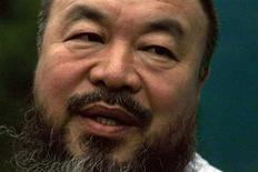<p>Dissident Chinese artist Ai Weiwei speaks to members of the media in the doorway of his studio after he was released on bail in Beijing June 23, 2011. REUTERS/David Gray</p>
