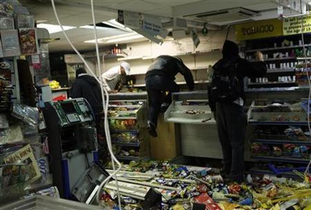 Looters rampage through a convenience store in Hackney, east London August 8, 2011. REUTERS/Olivia Harris