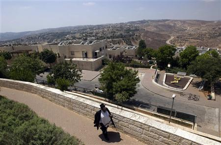 An ultra-Orthodox Jewish man walks in Ramat Shlomo, a religious Jewish settlement in an area of the West Bank annexed to Jerusalem by Israel August 11, 2011. REUTERS/Ronen Zvulun