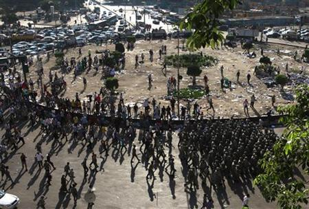 Army personnel (R) clear away protesters in Tahrir Square in Cairo, August 1, 2011. REUTERS/Asmaa Waguih