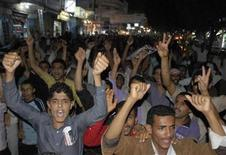 <p>Anti-government protesters shout slogans during a demonstration to demand the ouster of Yemen's President Ali Abdullah Saleh in the southern city of Taiz August 11, 2011. REUTERS/Stringer</p>