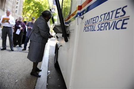 On the deadline day for U.S. citizens to file their income tax returns, a woman stands at the front of the line at a mobile post office near the Internal Revenue Service building in downtown Washington, April 15, 2010. REUTERS/Jonathan Ernst