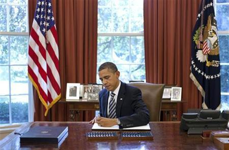 U.S. President Barack Obama signs the Budget Control Act of 2011 in the Oval Office at the White House in Washington, August 2, 2011. REUTERS/Pete Souza/The White House/Handout