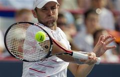 <p>Mardy Fish of the U.S. hits a return to Serbia's Janko Tipsarevic during their semi-final match at the Rogers Cup tennis tournament in Montreal, August 13, 2011. REUTERS/Christinne Muschi</p>