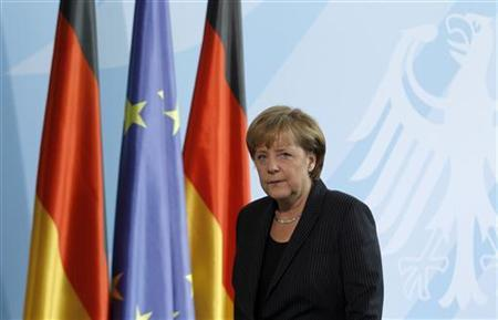 German Chancellor Angela Merkel leaves after a statement to the media in Berlin, July 23, 2011. REUTERS/Tobias Schwarz