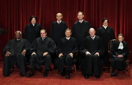 The justices of the U.S. Supreme Court gather for a group portrait in the East Conference Room at the Supreme Court Building in Washington, October 8, 2010. Seated from left to right in front row are: Associate Justice Clarence Thomas, Associate Justice Antonin Scalia, Chief Justice John G. Roberts, Associate Justice Anthony M. Kennedy, Associate Justice Ruth Bader Ginsburg. Standing from left to right in back row are: Associate Justice Sonia Sotomayor, Associate Justice Stephen Breyer, Associate Justice Samuel Alito Jr., and Associate Justice Elena Kagan. REUTERS/Larry Downing