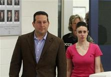 <p>Casey Anthony and her lawyer Jose Baez (L) leave the Orange County Jail in Orlando, Florida July 17, 2011. REUTERS/Red Huber/Pool</p>