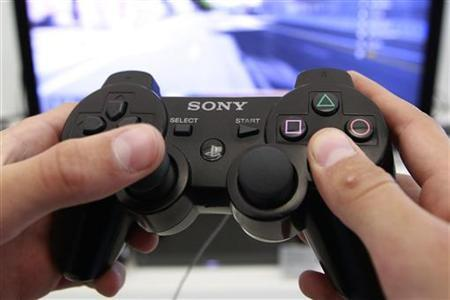 A person plays a video game at a Sony Playstation in the Sony's flagship store in Berlin, April 27, 2011. REUTERS/Thomas Peter