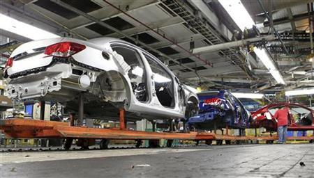 Chevrolet Cruze car chassis move along the assembly line at the General Motors Cruze assembly plant in Lordstown, Ohio July 22, 2011. REUTERS/Aaron Josefczyk