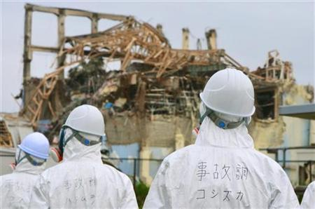 Members of the Japanese government panel to investigate the accident at Fukushima nuclear power plant, inspect the damaged building housing the No.3 reactor at the Tokyo Electric Power Company (TEPCO)'s Fukushima Dai-ichi nuclear power plant in Fukushima prefecture, in this handout picture taken by the investigation panel on June 17, 2011 and distributed by Kyodo on June 18, 2011. MANDATORY CREDIT REUTERS/Kyodo COMMERCIAL OR EDITORIAL SALES IN JAPAN