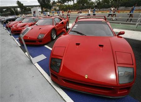 Ferrari cars, including the F40 (R and 2nd R), F50 (2nd L) and Enzo sit on display during a show of luxury cars in Singapore December 7, 2008. REUTERS/Vivek Prakash