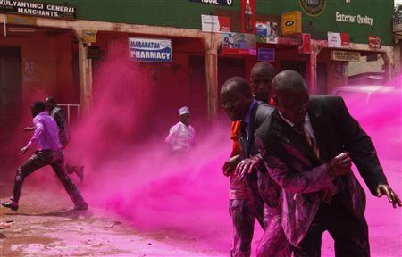 Anti-riot police officers use coloured water to disperse opposition supporters in the Kireka area on the outskirts of Kampala, August 17, 2011. REUTERS/James Akena