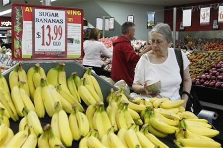 A customer looks bananas in a supermarket in Sydney April 27, 2011. REUTERS/Daniel Munoz