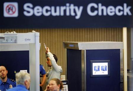 A passenger is scanned using ''backscatter x-ray technology'' at a security check-point at Logan Airport in Boston, Massachusetts November 22, 2010. REUTERS/Brian Snyder