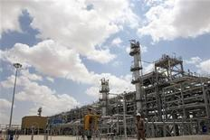 <p>A worker walks in the Ebla natural gas plant near Homs, northeast of Damascus, April 22, 2010. Suncor Energy Inc, Canada's No. 1 oil and gas producer has begun producing natural gas from the C$1.2 billion ($1.2 billion) Ebla project in Syria. The plant will produce 2.3 million cubic metres per day (mcm/d), the head of the Syrian operation Jon Ferrier told Reuters. Suncor, which took over management of the development when it acquired Petro-Canada last year, said in a release it is now selling gas into the Syrian market after its operations were approved by the Syrian government. REUTERS/Khaled al-Hariri</p>