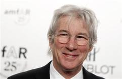 <p>Actor Richard Gere arrives for the amfAR New York Gala which begins Fall 2011 Fashion Week in New York February 9, 2011. REUTERS/Lucas Jackson</p>