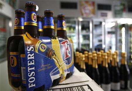 A six pack of Fosters beer is seen at a liquor store in Melbourne in this February 15, 2011 photo illustration. REUTERS/Mick Tsikas