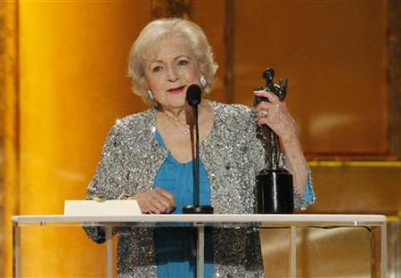 Betty White accepts the award for outstanding female actor in a comedy series for her role in ''Hot in Cleveland'' at the 17th annual Screen Actors Guild Awards in Los Angeles, California, January 30, 2011. REUTERS/Mario Anzuoni