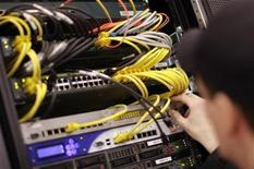 <p>A worker prepares prepares a network server of a stand for the upcoming CeBIT fair inside a hall in Hanover February 27, 2009. REUTERS/Hannibal Hanschke</p>
